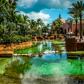 Atlantis Park by Joseph Law - City,  Street & Park  City Parks ( ponds, building, bushes, coconut trees, reflections, trees, city park, bahamas, atlantis )