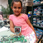 Young student with her 'Cheetah' made from old electronic parts.