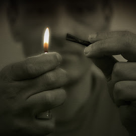 John by Robert Little - People Portraits of Men ( cigarette, face, selective color, black and white, flame,  )