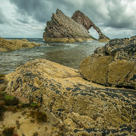 Bow Fiddle Rock. Portknockie, East coast of Scotland. by Peter Bartlett - Landscapes Caves & Formations