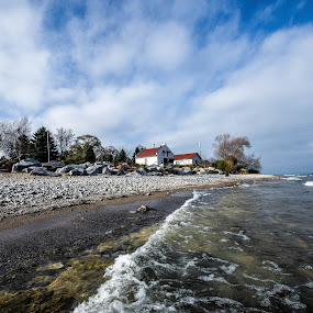 Beach at the Wind Point Lighthouse by Jason Lockhart - Landscapes Waterscapes ( clouds, lake michigan, waves, beach, wind point lighthouse )