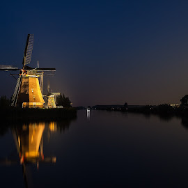 Kinderdijk at late blue hour by Rémon Lourier - Buildings & Architecture Statues & Monuments ( mill, reflection, waterscape, blue hour, holland, polder, windmills, world heritage, evening, unesco, windmill )