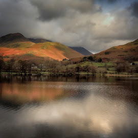 Stormy Skies over Buttermere Lake by Ceri Jones - Landscapes Waterscapes ( uk, reflection, cumbria, park, autumn, national, lake, beauty, scenic, quiet, district, buttermere )