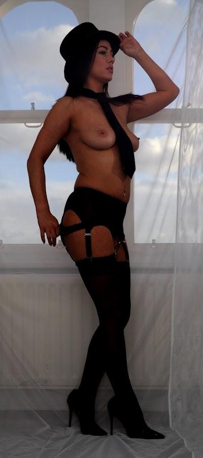 by DJ Cockburn - Nudes & Boudoir Artistic Nude ( model, topless, dark hair, home shoot, off-camera flash, net curtain, jess harrington, portrait, hat, caucasian, stockings, lingerie, belly button ring, window, navel piercing, woman, brunette, suspenders )