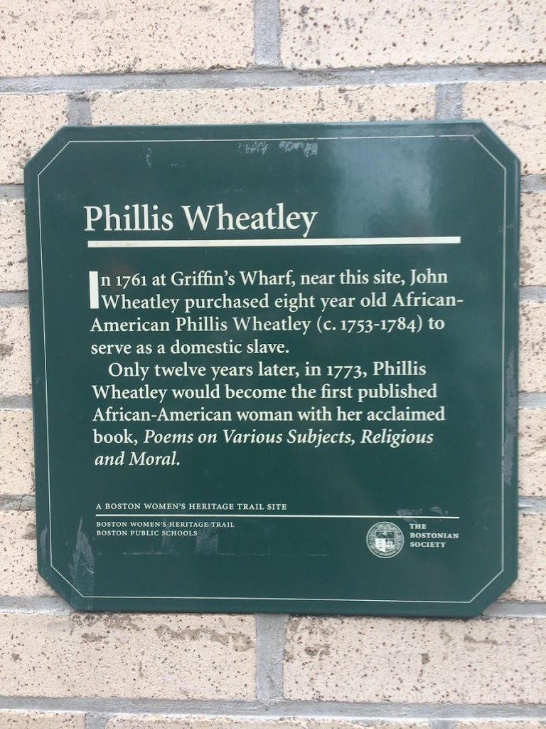 Phillis Wheatley In 1761 at Griffin's Wharf, near this site, John Wheatley purchased eight year old African- American Phillis Wheatley (c. 1753-1784) to serve as a domestic slave. Only twelve ...