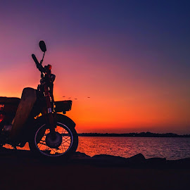 Evening Beauty by MaSs Balasooriya - Transportation Motorcycles ( water, blue sky, red, bike, waterscape, beautiful, motorcycle, yellow, beauty, tank, evening )