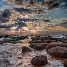 Reflections in the Sand by Jan Murphy - Landscapes Waterscapes ( sand, boulders, sky, blue, sunset, reflections, beach )