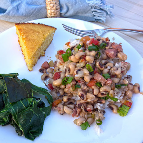Sticking with tradition, I serve the Hoppin' John over rice, with collards and cornbread.  Yum!