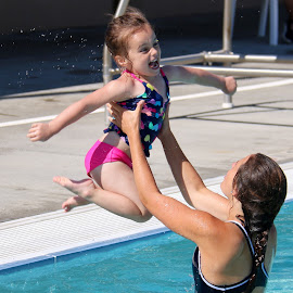 Jumping in the pool by Julia Van Klinken Myers - Babies & Children Children Candids ( water, happy, emotions, summer, swimming pool, summer fun, kids, fun, swimming )