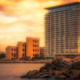 Condo On The Beach by Scott Hryciuk - Landscapes Travel ( shore, condo, building, mexico, ocean, sunrise, beach, rocks )