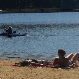 Sunbathing with canoe by Stephen Deckk - People Musicians & Entertainers