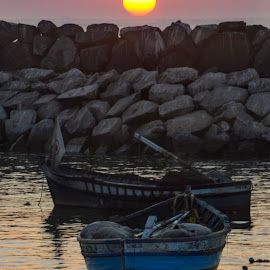Boats and Sunset by Fico Stein Montagne - Transportation Boats ( ocean, rocks, light, golden hour, sunset, nikon d7000, bay, boats, sun, sea, transportation )
