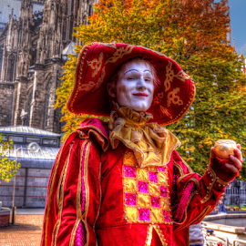Golden Apple by Darin Williams - People Musicians & Entertainers ( cologne, red, apple, cathedral, mime, street performer,  )