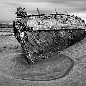Ebb tide by Steven Stamford - Transportation Boats ( black and white, wales, wreck, boat, wooden boat, coastal, deserted, wooden, watch house bay, barry island, mono, abandoned, rotting,  )