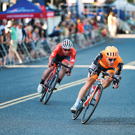 Rounding A Corner by Garry Dosa - Sports & Fitness Cycling ( racing, fast, outdoors, motion, tour de white rock, men, action, competitive, cycling, bicycles, people, speed )