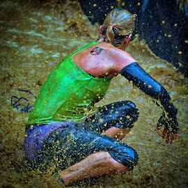Awkward Situation by Marco Bertamé - Sports & Fitness Other Sports ( water, splatter, splash, differdange, 2015, green, blond, waterdrops, soup, luxembourg, muddy, sitting, strong, woman, drops, lady, brown, strongmanrun )