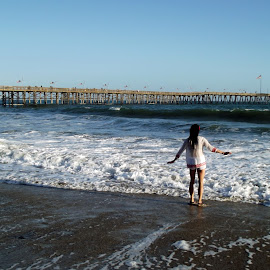 First Time In, Ventura, California USA by Jo Brockberg - Landscapes Beaches ( shore, water, sand, cali, wading, california, waves, ventura, pacific ocean, pacific, ocean, beach, travel, swimming, blue sky, girl, pier, day, public, salt )