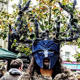 Halloween In Glastonbury  by Ian Popple - People Portraits of Men ( horns, mask, berries, rowan, halloween )