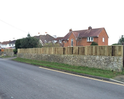 wooden fencing on top of a wall exeter