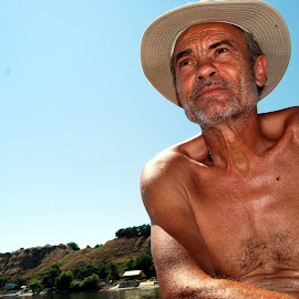 River wolf by Zoran Dangubić - People Portraits of Men ( color, view, fisherman, danube, river )