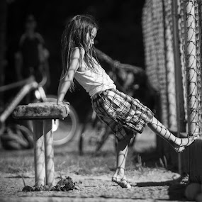 Feeling Alone by Garry Dosa - Black & White Street & Candid ( child, person, b&w, girl, park, sad, black & white, people, alone, shadows,  )