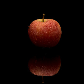 Apple in the mirror by Kim  Schou - Food & Drink Fruits & Vegetables ( water, mirror, flash, red, apple, drops, black )