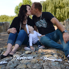 The kiss by Julene Muller - People Family ( shoes, kiss, kissing, family, jeans, baby girl, couple, baby, cute, rocks )