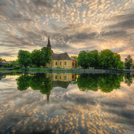 D o d g i n g - F o r -T h e - D a r k - C l o u d s by Manu Heiskanen - Uncategorized All Uncategorized ( clouds, tower, reflection, church, sunset, cityscape, cloudporn, paulinawolekpardon )
