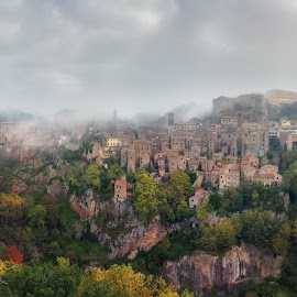 Italy. Tuscany. Panorama of the city Sorano by Александр Науменко - Landscapes Travel ( old, europe, italian, tuscany, exterior, stone, travel, cityscape, architecture, house, landscape, historic, heritage, city, aged, ancient, village, nature, sorano, mediterranean, tuff, italy, hill, building, toscana, vintage, tourism, dusk, urban, landmark, tower, european, fog, background, town, view, tuscan, medieval, antique, culture, grosseto, panoramic )