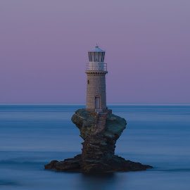 Lighthouse Blues by Bill Peppas - Landscapes Waterscapes ( water, calm, hellas, andros, greece, lighthouse, sea, ocean, lake, relaxing, dusk, cyclades, kykladres, waters, light house, mediterranean, pond, blues )
