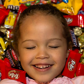 Joy by Joseph Belcher - Babies & Children Children Candids ( girl, candy, happy, joy, pile, smile, young, kid )