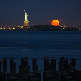 Statue of Liberty Moonset by Logan Knowles - Buildings & Architecture Statues & Monuments ( moonset, statue of liberty, red moon, blue hour, monument, morning )