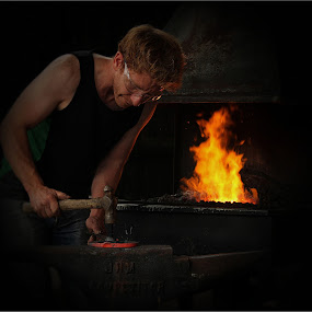 The Young Blacksmith by Carol Lauderdale - People Professional People ( heat, horseshoe, blacksmith, metal work, forge, fire )