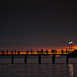 Between Dusk and Night by Garry Dosa - Landscapes Waterscapes ( water, orange, waterscape, silhouette, sunset, pier, ocean, people )