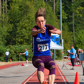 Moving Forward by Garry Dosa - Sports & Fitness Other Sports ( woman, sports, long jump, outdoors, jumping, games, track and field, athletes, female, people, summer )