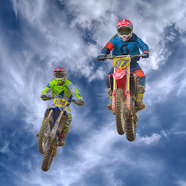 Sky Riders by Marco Bertamé - Sports & Fitness Motorsports ( clouds, 97, speed, green, number, yellow, race, jump, noise, flying, red, sky, motocross, blue, cloudy, 104, air, high )
