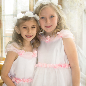 Pair of Cuties by Ted Anderson - Babies & Children Child Portraits ( sisters, two girls, wedding, flowers, white dresses )