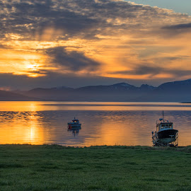 Boats in Midnightsun by Jens Andre Mehammer Birkeland - Transportation Boats ( clouds, water, reflection, mountain, midnight, grass, green, boats, sea, boat )