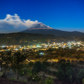 Small town and Smoking volcano by Cristobal Garciaferro Rubio - Landscapes Travel