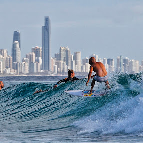 Gold Coast surfer by Howard Ferrier - Sports & Fitness Surfing ( highrise, reflection, burleigh heads, hdr, male, reflections, beach, mirror, burleigh, surfer, gold coast, surfboard, wave, buildings, surf, man, Urban, City, Lifestyle,  )