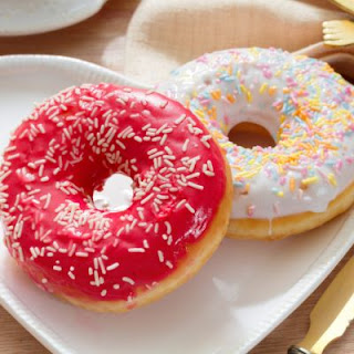 Vanilla Frosted Doughnuts With Sprinkles