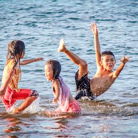 Three children by Wing Yin Cheong - Babies & Children Children Candids ( playing, water, girls, sea, children, fun, beach, wet, boy, philippines, and )