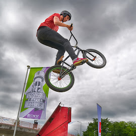 by Marco Bertamé - Sports & Fitness Other Sports ( two, flying, red, cloudy, grey, dow, rampwheel, jump )