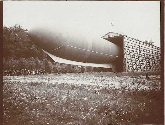 """Belgique I"" (1909), the first Belgian airship, built by Robert Goldschmidt (1877-1935) and funded by Ernest Solvay. Goldschmidt, a brilliant inventor, developed several wireless systems, as well as the first microfiche device for a certain ... Paul Otlet. He also contributed to the organizing of the first Solvay Physics Council, by putting the physicist Walther Nernst in contact with Solvay who financed it. © Solvay Heritage Collection."