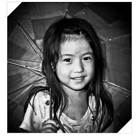 a monochrome girl in colorless rain  by Satyam Joshi - Babies & Children Children Candids ( peple, pwcface, kathmandu, pwc, monochrome, black & white, children, pwcpeople, pwcportrait, pwcchildren, portrait, nepal )