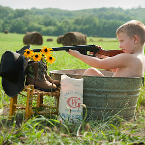 Young Gun by Tiffany Lett - Babies & Children Child Portraits ( cowboy hat, hay, outdoor, tub, western, boy, boots, gun )