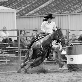 Chasing Success by Brian  Shoemaker  - Black & White Sports ( speeding, turnandburn, barrelracer, barrels, black and white, horse, rodeo, cowgirl )