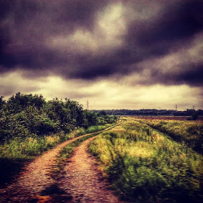 Lonely path by Nat Bolfan-Stosic - Landscapes Prairies, Meadows & Fields ( clouds, field, village, path, lonely )
