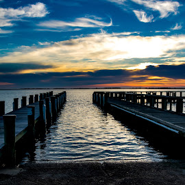 Assateague Island boat launch and sunrise.  by Carol Ward - Landscapes Waterscapes ( assateague island, boat launch, pier, sunrise, boat dock at sunrise,  )