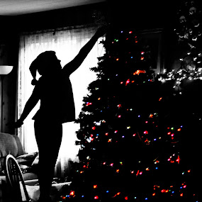 Looking through old photo albums and found this one of my sister topping the tree at christmas:) I love Christmas! by Annamarie Dearr - Babies & Children Child Portraits